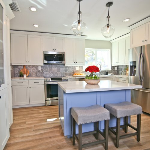 Contemporary Kitchen with shaker cabinets and blue island.