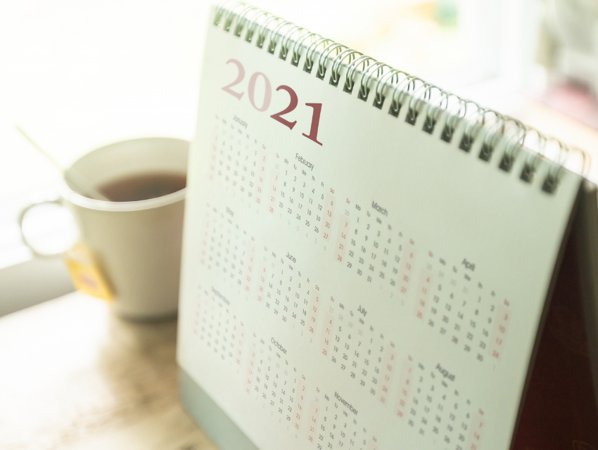 Darla-Powell-Interiors_Miami-FL_The-Truth-Behind-Design-Project-Timelines-Revealed_2021-Calendar-with-Mug-on-Desk